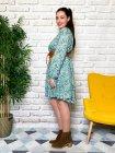 Bérénice robe grande taille imprimé fleuri verte profil
